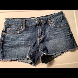 Paige Ladies Blue Jean Raw Hem Shorts
